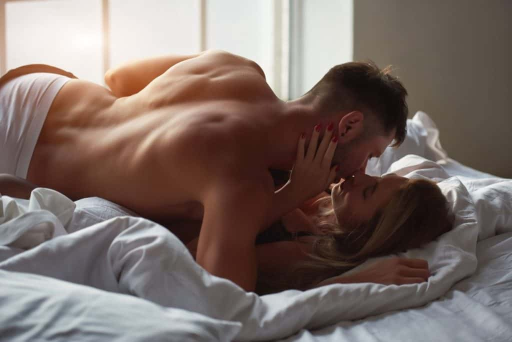 young members from shagle kissing passionately on bed